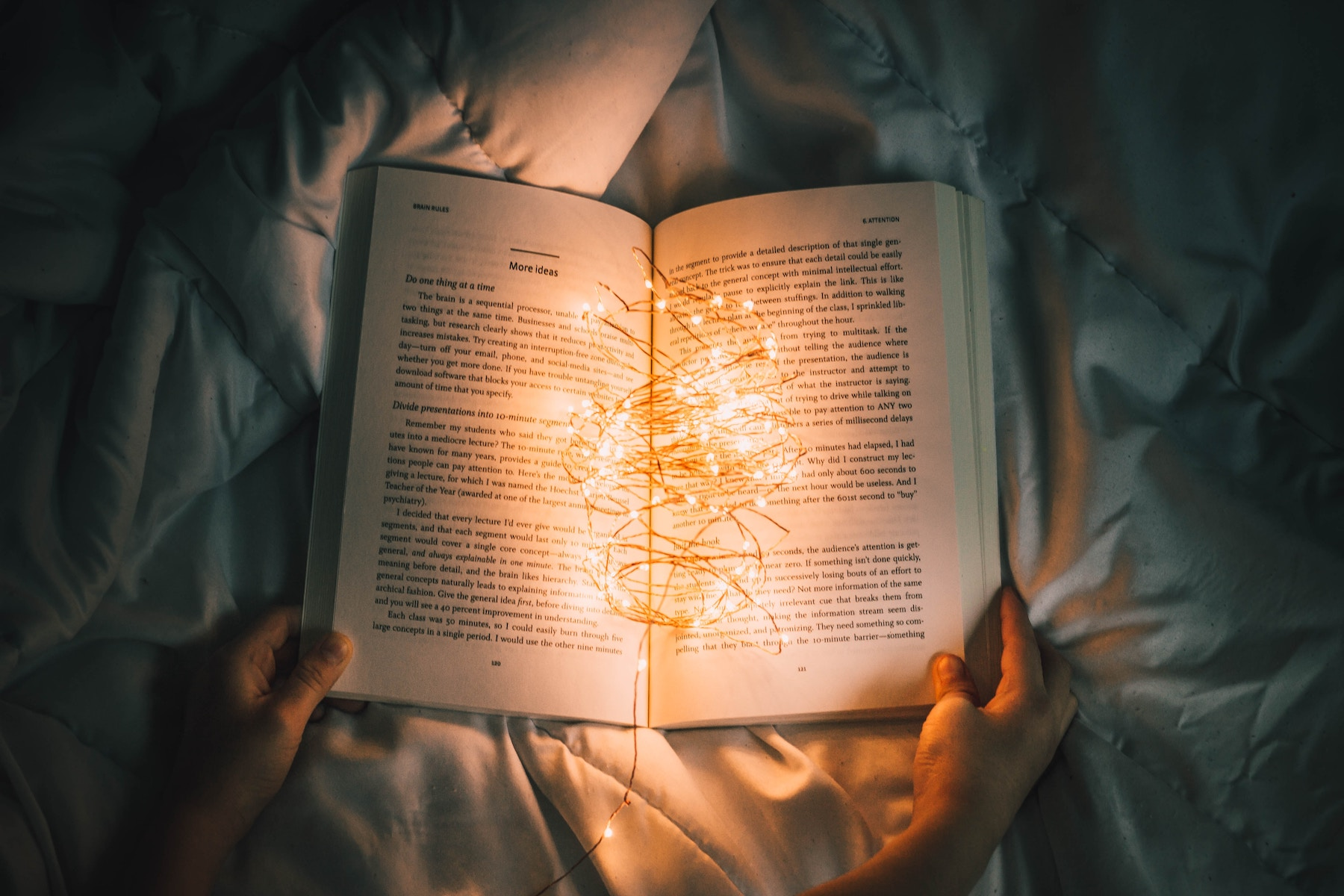 Photo of person reading in the dark by Nong Vang, Unsplash.