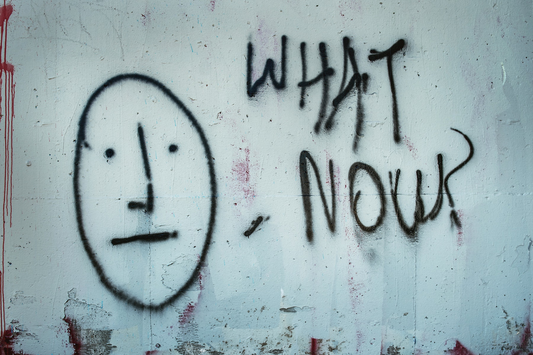 Photo of graffiti asking What Now?