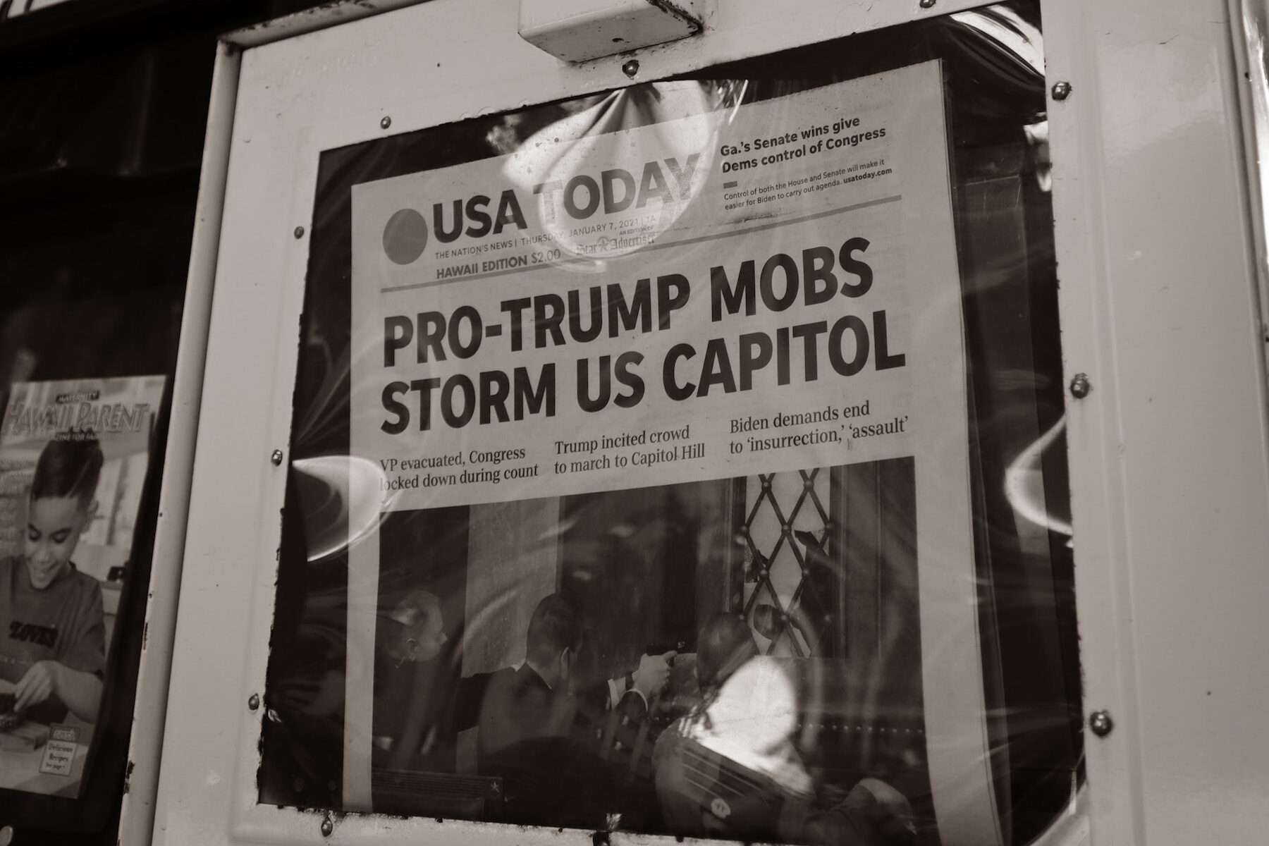 Newspaper headline about US Capitol attacks. Jan 7, 2021. Photo by little plant on Unsplash.